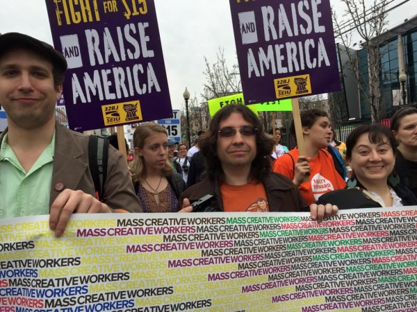 Mass. Creative Workers at the April 14th rally for living wages in Boston. Jason Pramas is in the center; Loreto Paz Ansaldo is on the right..